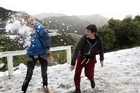 Jess Fraser, 20, and brother Seth, 13, of Akatarawa, play in the snow on the Rimutaka Hill Road which was closed until early afternoon yesterday. Picture / APN