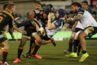 Pat McCabe of the Brumbies runs into some strong Chiefs defence in Canberra. Photo / Getty Images