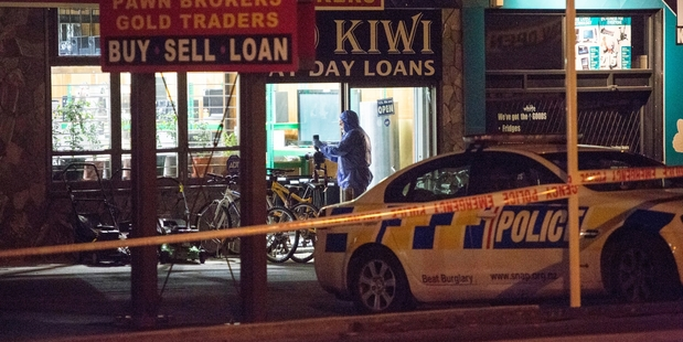 Scene of crime officers cordoned off the Ezy Cash store last night. Photo / Chris Loufte