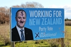 A billboard featuring Prime Minister John Key, put up by Tukituki MP Craig Foss on Karamu Rd North, is among the latest to suffer a vandalism attack. Photo / Duncan Brown