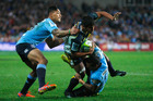 Jarrad Butler of the Brumbies is tackled during the Super Rugby semi final against the Waratahs. Photo / Getty Images
