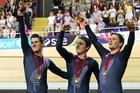 New Zealand men's sprint team Sam Webster, Ethan Mitchell and Eddie Dawkins celebrate their victory. Photo / Greg Bowker