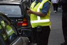 Parking warden on patrol on High Street in Auckland's CBD. Photo / Steven McNicholl
