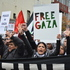 Protesters march down Queen St during a rally to protest Israeli military action in Gaza. Photo / Eli Orzessek