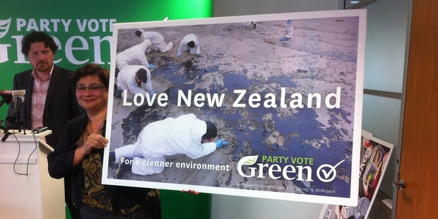 One of the billboards featuring an Rena oil spill scene.