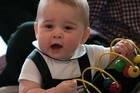 Britain's Prince George celebrates his first birthday wednesday, capping a year in which the globetrotting infant became the face of the modern royal family.