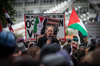 John Minto addresses the crowd at a rally to protest the Israeli ground invasion of Gaza. Photo / Herald on Sunday photograph / Michael Craig