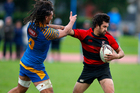 Whaka's Te Rangi Fraser fends off Beau Williams of Tauranga Sports in the weekend's clash. PHOTO ANDREW WARNER