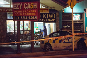Scene of crime Police officers working at the Ezy Cash store on Great South Road Takanini. Photo / APN