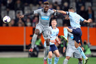 Mapou Yanga-Mbiwa of Newcastle United climbs high to win the ball during the international friendly match between Newcastle United and Sydney FC at Forsyth Barr Stadium. Photo / Getty Images