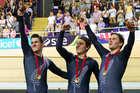 New Zealand Men's Sprint team Sam Webster, Ethan Mitchell and Eddie Dawkins celebrate their Gold Medal. Photo / Greg Bowker.