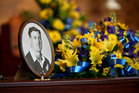 A photo of Kevin Skinner sits on his casket at the funeral service at Holy Cross Catholic Church in Henderson. Photo Jason Oxenheim