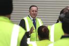 Prime Minister John Key talks to workers.