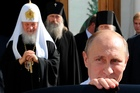 Vladimir Putin, pictured after a meeting with Russian Orthodox Patriarch Kirill, left, fulfilled his presidential promise to