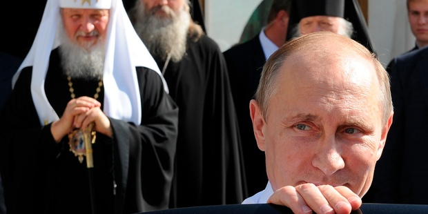 "Vladimir Putin, pictured after a meeting with Russian Orthodox Patriarch Kirill, left, fulfilled his presidential promise to ""waste"" Chechen terrorists. Photo / AP"