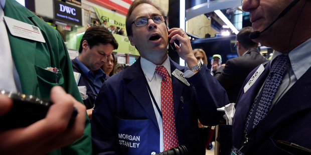 Trader Dudley Devine, center, works on the floor of the New York Stock Exchange. File photo / AP