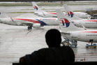 A visitor looks out on the tarmac at the Kuala Lumpur International Airport (KLIA). Photo / AP