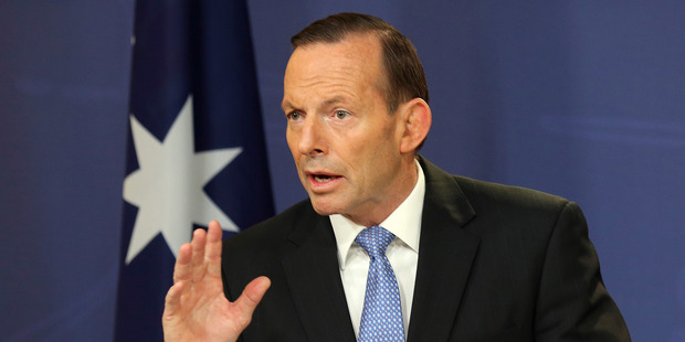 Australian Prime Minister Tony Abbott vowed to maintain pressure on Vladimir Putin after a phone call to the Russian President. Photo / AP