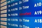 A departure board at the Philadelphia International Airport shows that US Airways Flight 796 to Tel Aviv has been cancelled after FAA directive. Photo / AP