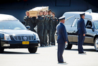 Pallbearers carry a coffin towards a hearse during a ceremony to mark the return of the first bodies, of passengers and crew killed in the downing of Malaysia Airlines Flight 17. Photo / AP