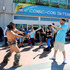 A sword wielding warrior works with a video crew outside the convention centre in San Diego. (Photo by Denis Poroy/AP)