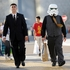 That's Jack Black who despite the Stormtrooper helmet needs his own personal escort (Photo by Chris Pizzello/Invision/AP)