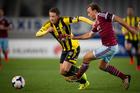 Nathan Burns of the Wellington Phoenix and Mark Noble of West Ham during last night's game. Photo / Sarah Ivey