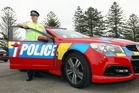 Hawke's Bay Road Policing received three red and orange police cars this week, as part of a national roll-out to increase motorists' awareness of police. Photo / APN