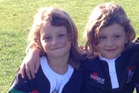 Zarah and Alexis Thomson, 7, in their Waitemata Rugby Team jerseys that were stolen from a car outside a Tikipunga business but have now been returned.
