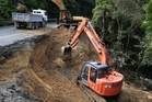 Contractors work on a large slip that has closed State Highway One across the Brynderwyns, with the detour adding up to 40 minutes to travel times to and from the region. Photo/Michael Cunningham