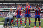 Knights players line up as a mark of respect to Alex McKinnon, left, before the Rise for Alex round. Photo / Getty Images