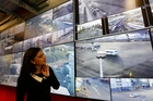 Technical analyst Mohini Singh  in front of the  screens  at the new Auckland Traffic Operations Centre on Queens Wharf. Picture /Chris Gorman