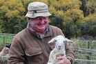 Brian Hales with a rare Damara lamb, the start of his Meatmaster flock. Photo/Christine McKay