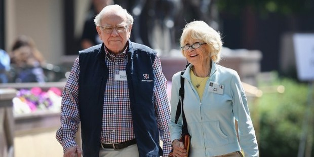 Chairman of Berkshire Hathaway Warren Buffett and his wife Astrid. Warren Buffett could soon have to bid adieu to another of his high-yielding investments from the financial crisis. Photo / AFP