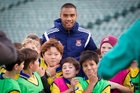 West Ham United's Kiwi connection Winston Reid spent some time playing football with young fans at North Habour Stadium. Photo / Sarah Ivey