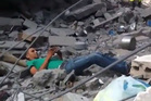 The man on the ground amid rubble after being shot for the first time. Photo / You Tube