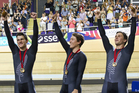 New Zealand men's sprint team Sam Webster, Ethan Mitchell and Eddie Dawkins celebrate their gold medal. Photo / Greg Bowker