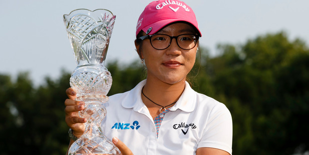 Lydia Ko, of New Zealand, holds up her trophy after winning the Marathon Classic LPGA tournament. Photo / AP