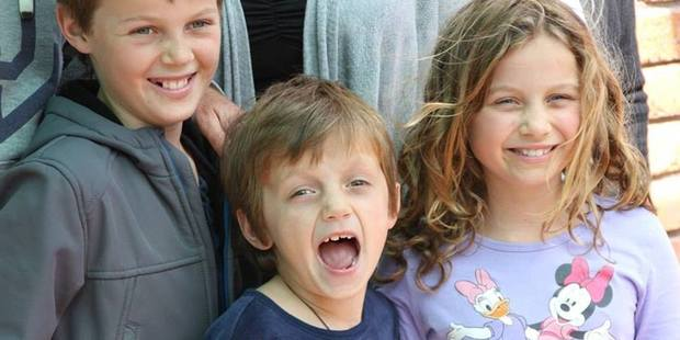 Child victims of Malaysia Airlines MH17 Mo Maslin, 12, (left), his brother Otis, eight, (centre) and sister Evie Maslin, 10, (right) were killed on the flight along with their grandfather Nick Norris.