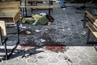 A trail of blood is seen in the courtyard of a UN School in the northern Beit Hanun district of the Gaza Strip on after it was hit by an Israeli tank shell. Photo / AP