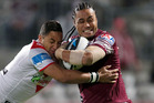 Steve Matai of the Sea Eagles is tackled by Benji Marshall. Photo / Getty Images