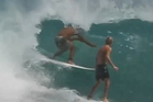 Tim Thompson getting ready to tackle a Brazilian surfer. Photo / YouTube