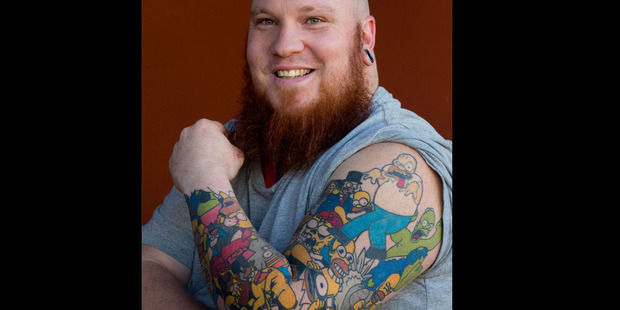 Loading Lee Weir shows off his Homer Simpson tattoos. Photo / Brett Phibbs