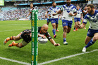 Keith Lulia of the Tigers scores the second of his four tries. Photo / Getty Images