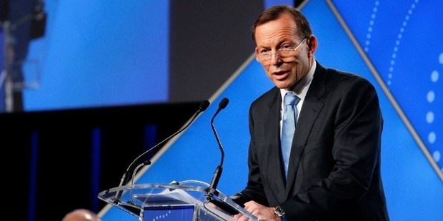 Australian PM Tony Abbott at the B20 Summit in Sydney. To pass laws, Abbott has to win the support of six of the eight lawmakers sitting in the upper house. Photo / AP