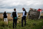 Alexander Hug, centre, deputy head of the OSCE mission, stands at the crash site of a Malaysia Airlines jet near the village of Hrabove, eastern Ukraine. Photo / AP