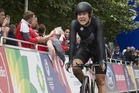 New Zealand cyclist Linda Villumsen crosses the finish line in the women's time trial. Photo / Greg Bowker