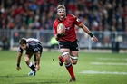 Kieran Read charges in to score for the Crusaders who outplayed the Sharks with their clever running and kicking game in Christchurch. Photo / Getty Images