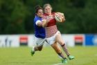 England's Lydia Thompson bursts upfield against Samoa. Photo / Getty Images