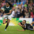 South Africa's Seabelo Senatla breaks past weak New Zealand defence in the Rugby Sevens Final at Ibrox Stadium in the XX Commonwealth Games in Glasgow. Photo / Greg Bowker